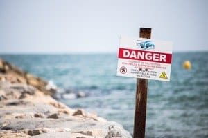 danger sign on the coast to illustrate dangers of nuts