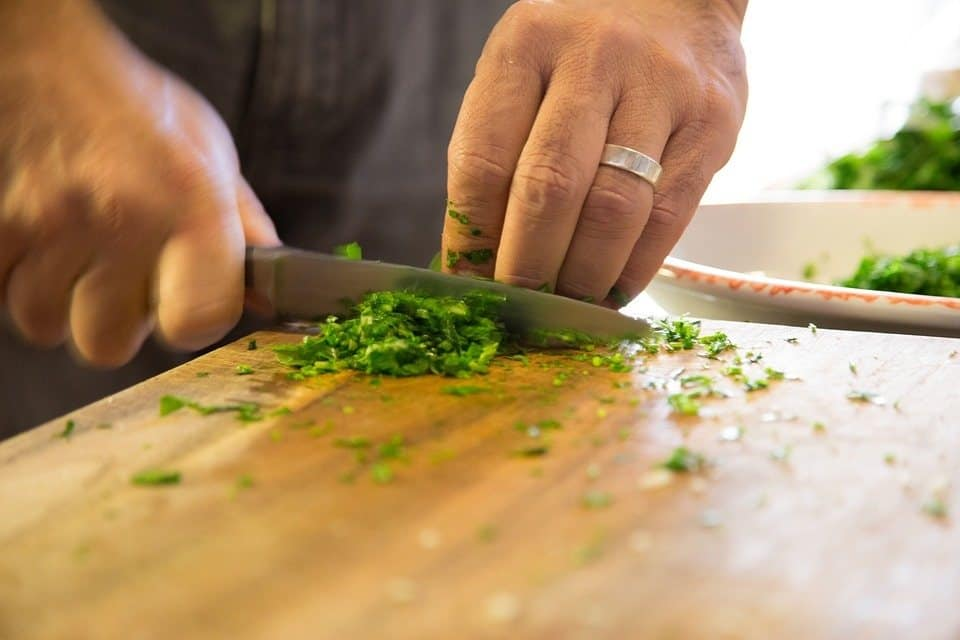 Weight loss tips: photo of person chopping herbs for cooking