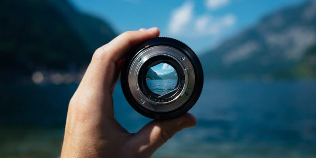 Camera lens focusing on target point in landscape
