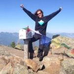 Stella Loichot, Health Coach, happy at the top of mountain after Mail Box Hike