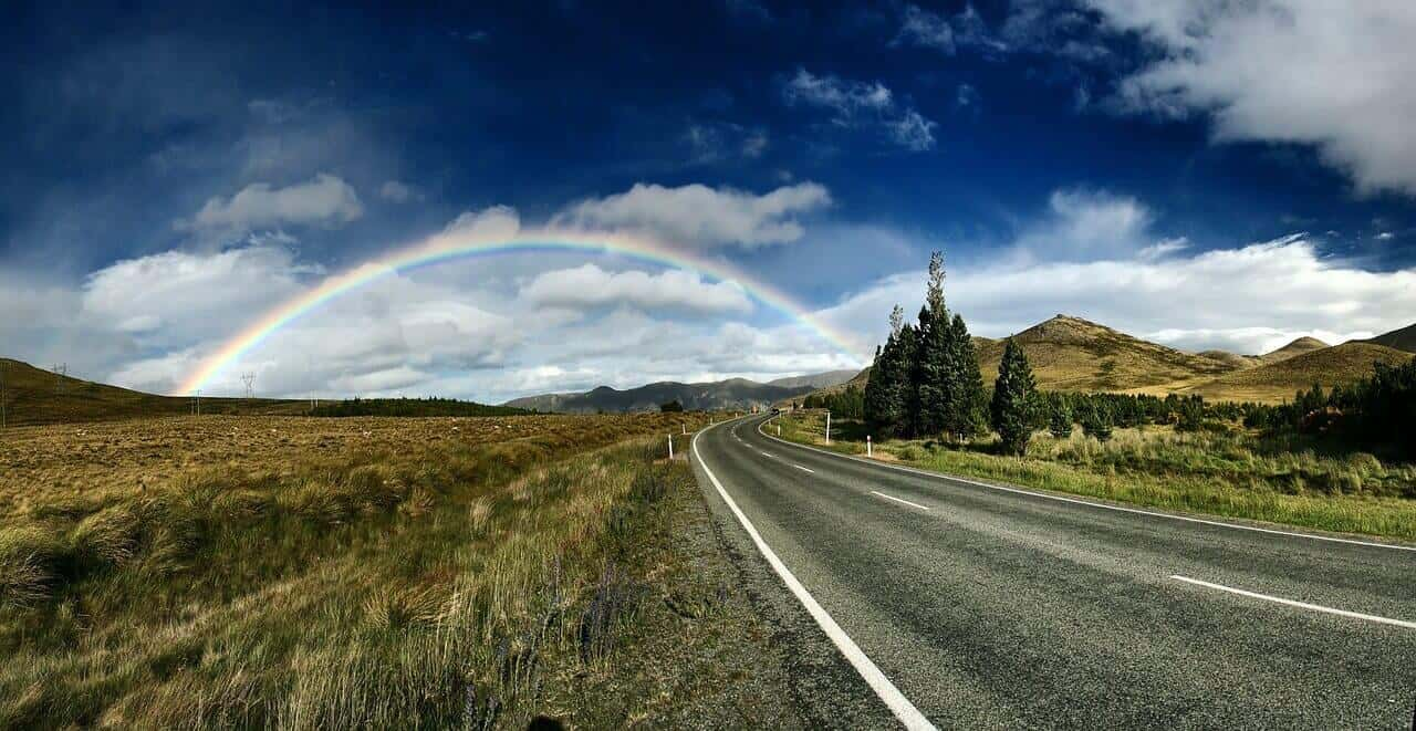 Beautiful road leading to rainbow and happy place