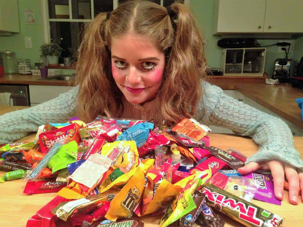 Halloween trick or treater with her candy