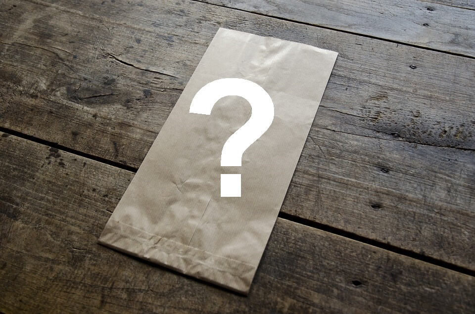Brown paper bag with question mark to represent lack of ideas of healthy snacks with protein